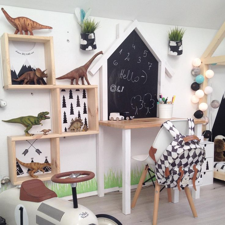 Boy's dinosaur room with desk and house shaped chalkboard - Wild One