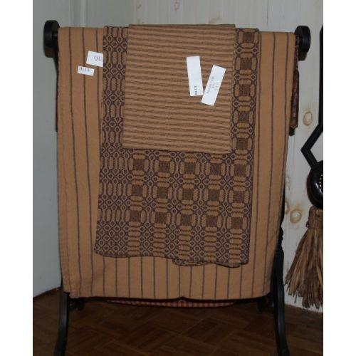 Homespun blanket #12 in blue stripe on tan.  Shown with TN lovers knot throw in brown/blue/tan