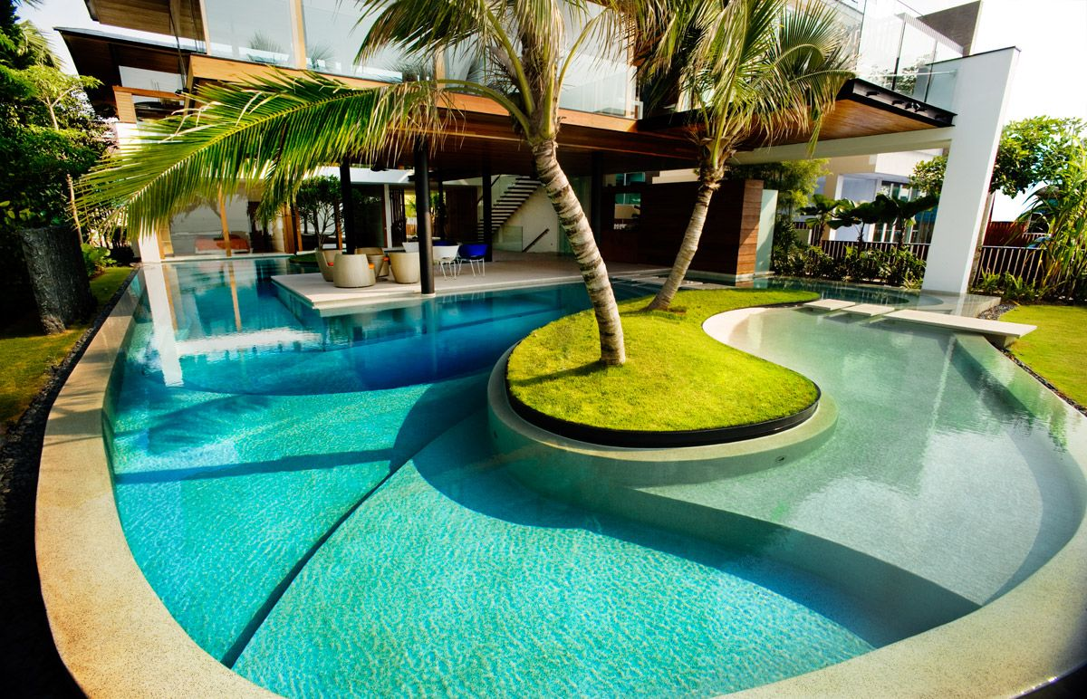 luxury house architecture with outdoor lounge area feat cool curved swimming pool plus green lawn cool