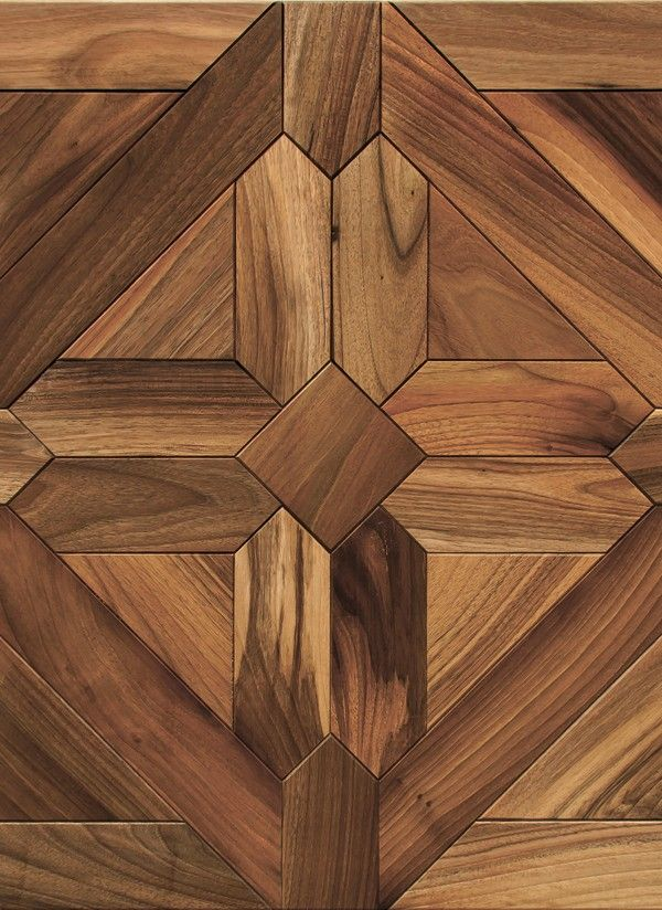 beautiful parquet flooring in a repeating pattern chosen to compliment the style of our living room
