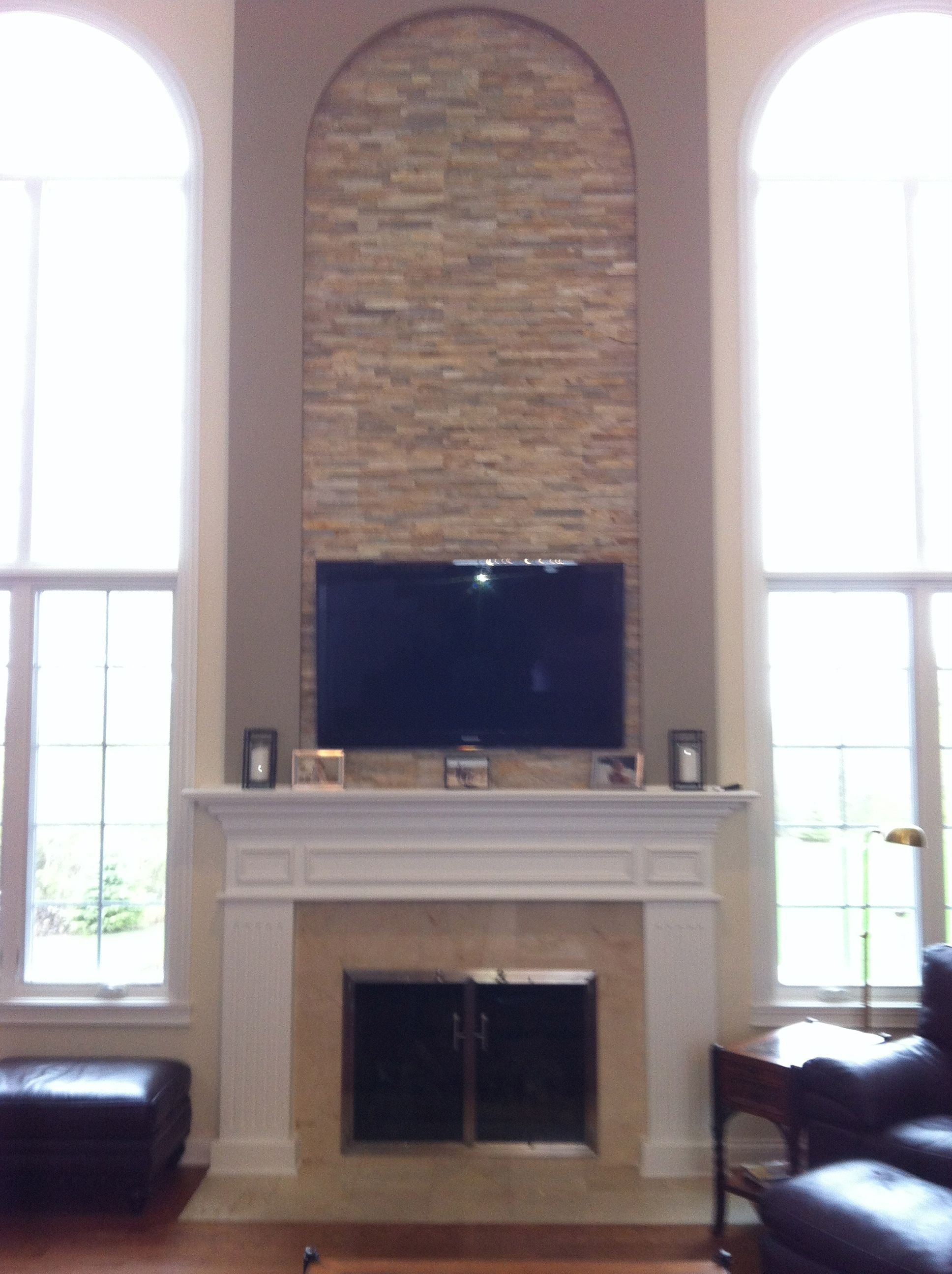 2 Story Stone Fireplace Stone Inlaid Tv Above Fireplace Custom Surround By Wendt Wood Working