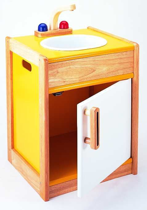 SinkWith this beautiful yellow sink piece, your child with have hours of fun helping you with the washing up. This sink comes with a removable washing bowl so its easy for you to clean and the tap knobs really turn! The knobs are coloured red and blue to help your child learn the difference between the hot and cold tap. There is also a cupboard underneath for storage space! W40xD35xH52cm . Easy to assemble
