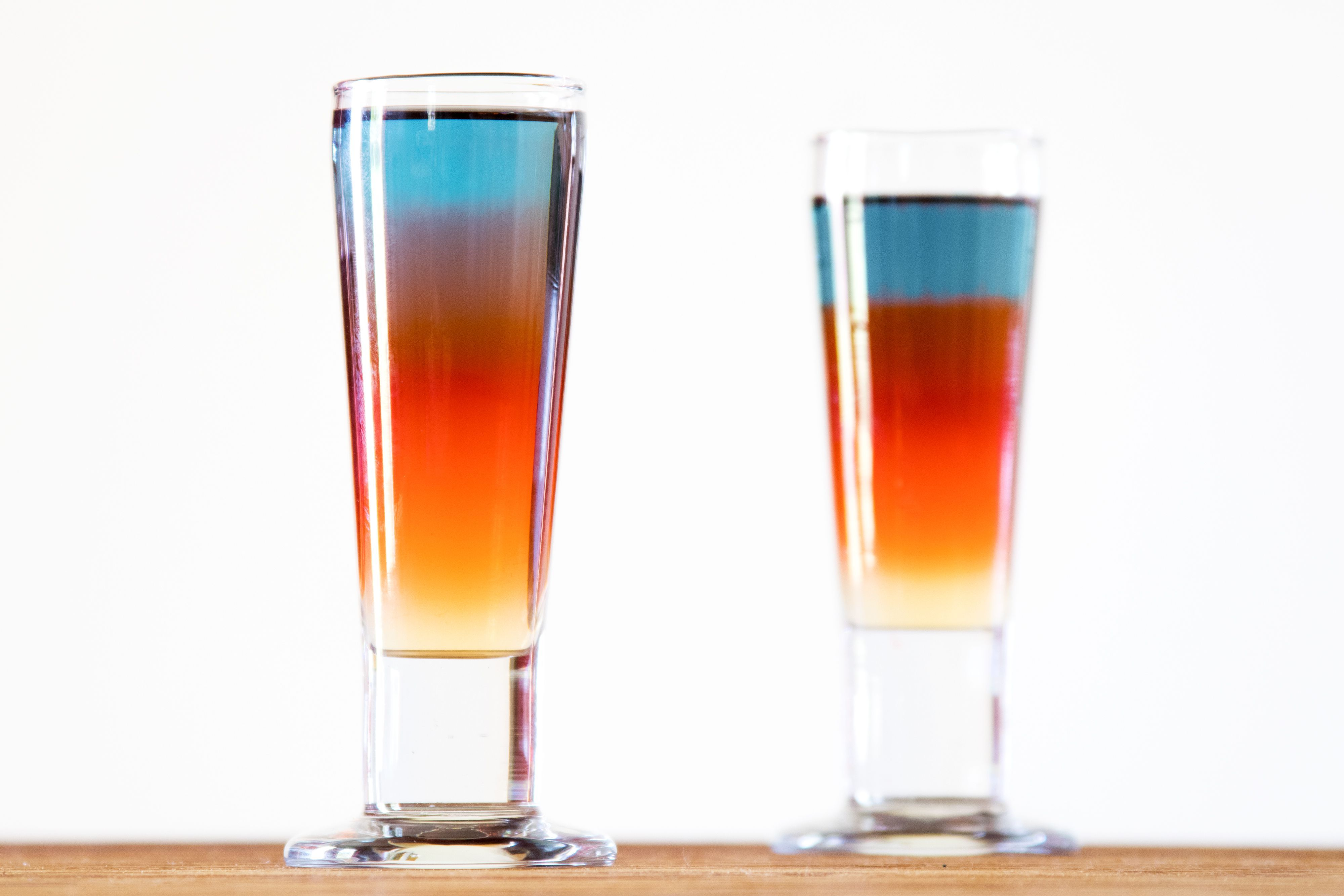 Learn How To Make An Impressive Looking And Delicious Superman Shot This Shooter Recipe Includes Blue Red And G In 2021 Shooter Recipes Layered Shots Superman Drink