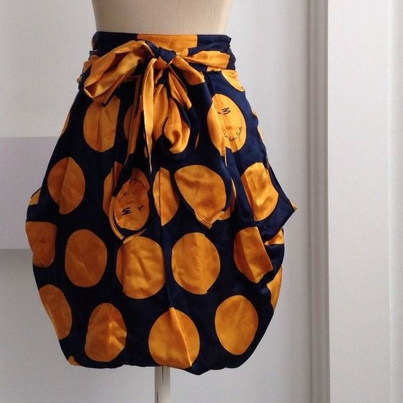 "Marc by Marc Jacobs Mini Skirt Navy and mustard polka dot tie front skirt (sits at waist). Fabric: Shell: 52% cotton, 48% silk; Lining: 52% cotton, 48% silk. Side zipper with hook and eye closure. Loose decorative pockets at sides. Mannequin dimensions: neck-12"", bust-33"", waist-25"", height-65"". Marc by Marc Jacobs Skirts Mini"