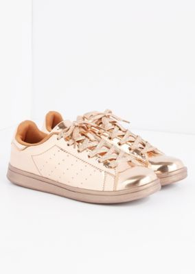 Not for the tame dresser. This fun and quirky skater sneaker comes in shiny metallic and features sparkly laces.
