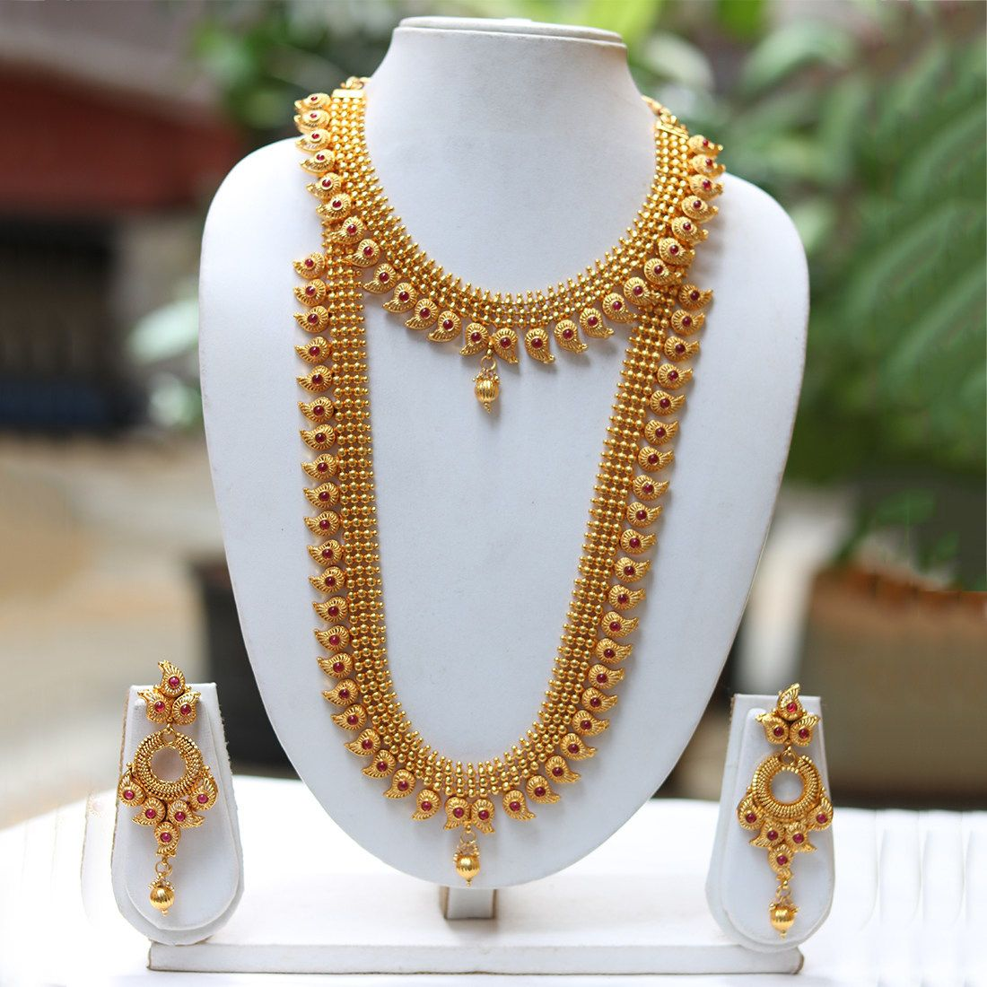 Buy Craftsvilla Latest Design Maroon Haram Necklace Set Online 100 Authentic Pro Gold Necklace Designs Gold Fashion Necklace Bridal Gold Jewellery Designs