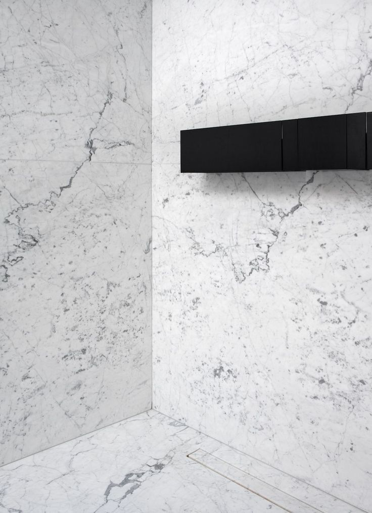 Minimalistic marble bathroom design    Tap and tow