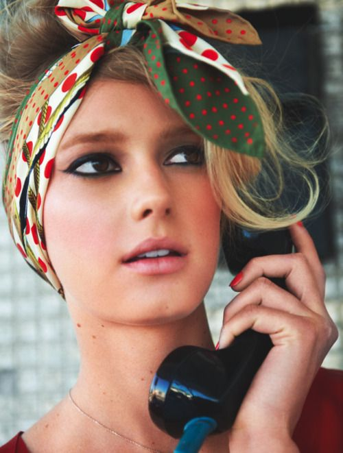 Summer look we want to try: cat eye + retro scarf-adorned updo.