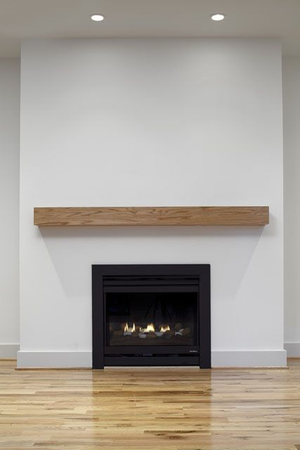 This Fireplace Wall Defines Modern Style With A Heat Glo Gas Fireplace Oak Block Ma Oak Fireplace Modern
