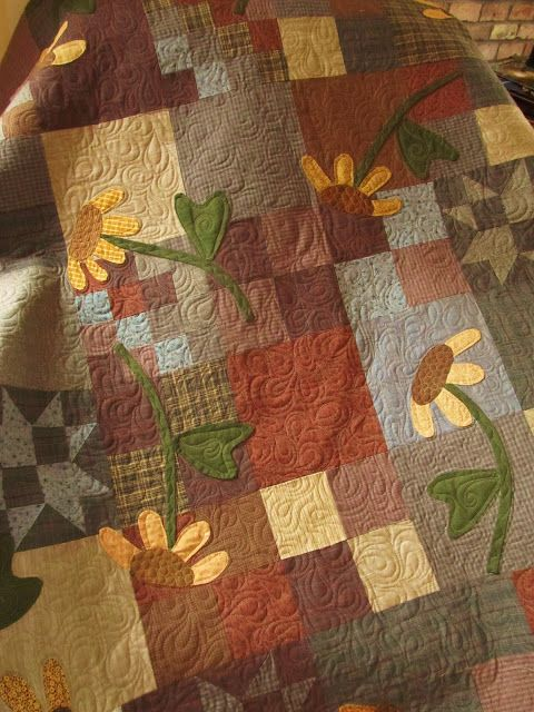 RobinHill Quilts~ love the appliquéd flowers placed over simple blocks