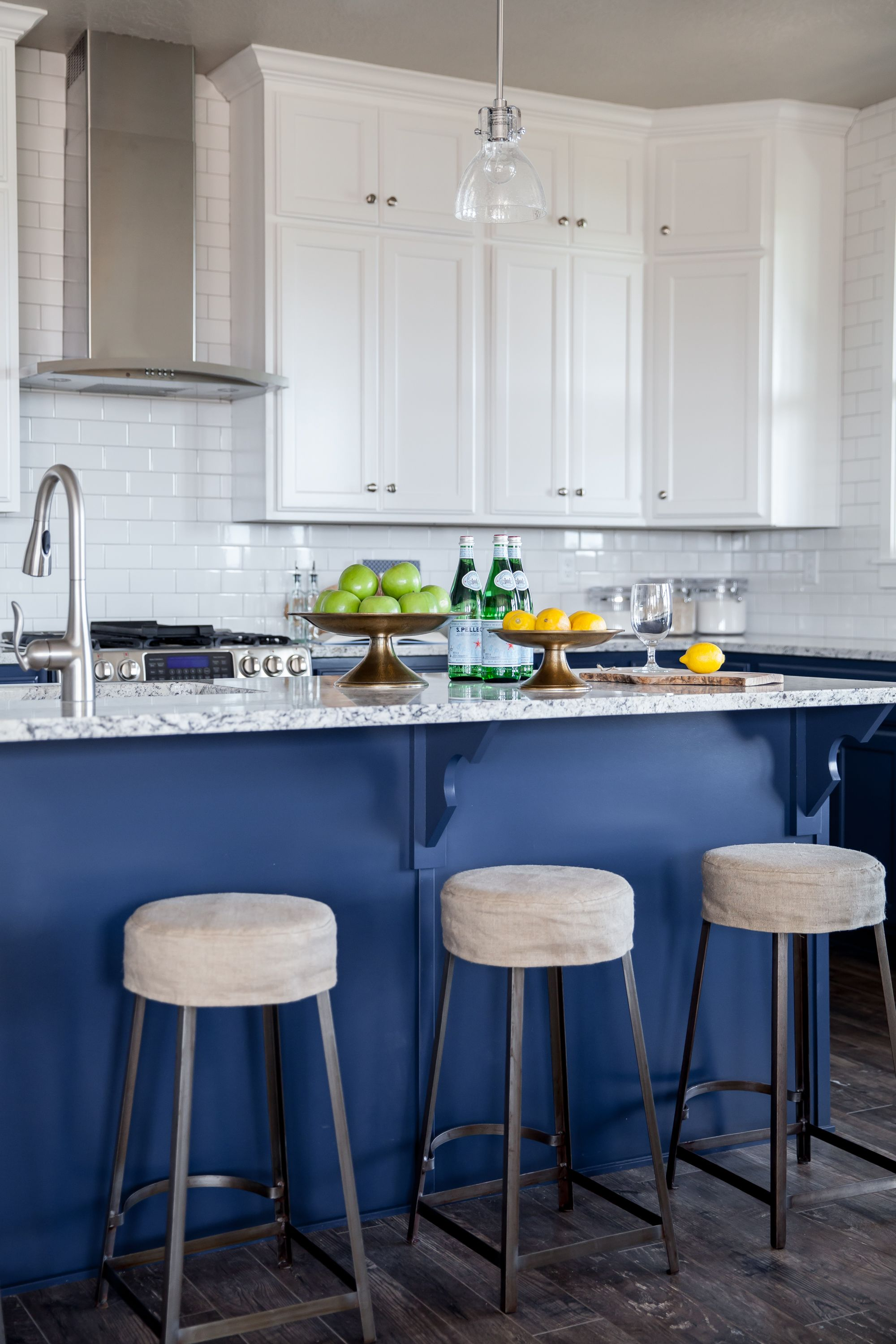 White Subway Tile An Indigo Blue Kitchen Island Cabinets And Industrial Stools In Alice Lanes Daybreak Lake Loft