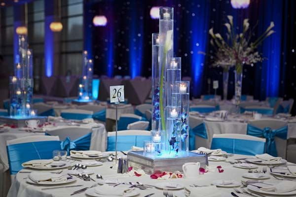 Round table turquoise white candle tower centerpiece south round table turquoise white candle tower centerpiece south asian junglespirit Choice Image