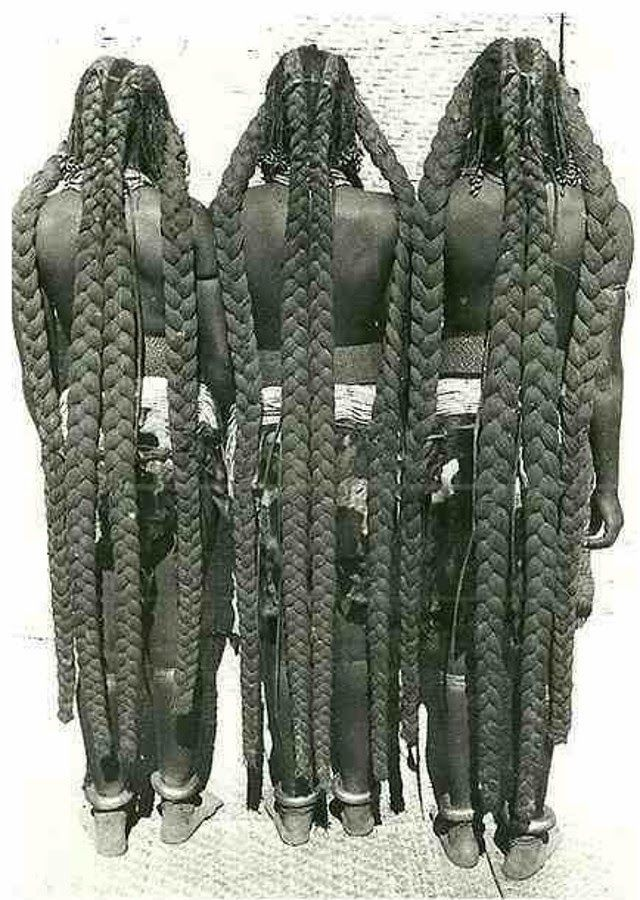 This hairstyle is known as Eembuvi Braids, worn by women of the Mbalantu tribes from the Namibia. It requires preparation from a young age, usually around twelve years old, when girls use thick layers of finely ground tree bark and oils– a mixture that is said to be the secret to growing their hair to such lengths. The girls will live with this thick fat-mixture on their scalp for several years before it's loosened. It will then be braided into various headdresses throughout their life.