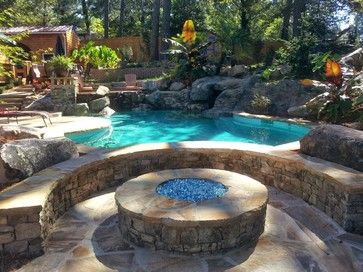 Raised Stacked Stone Wall On Swimming Pool And Gas Firepit