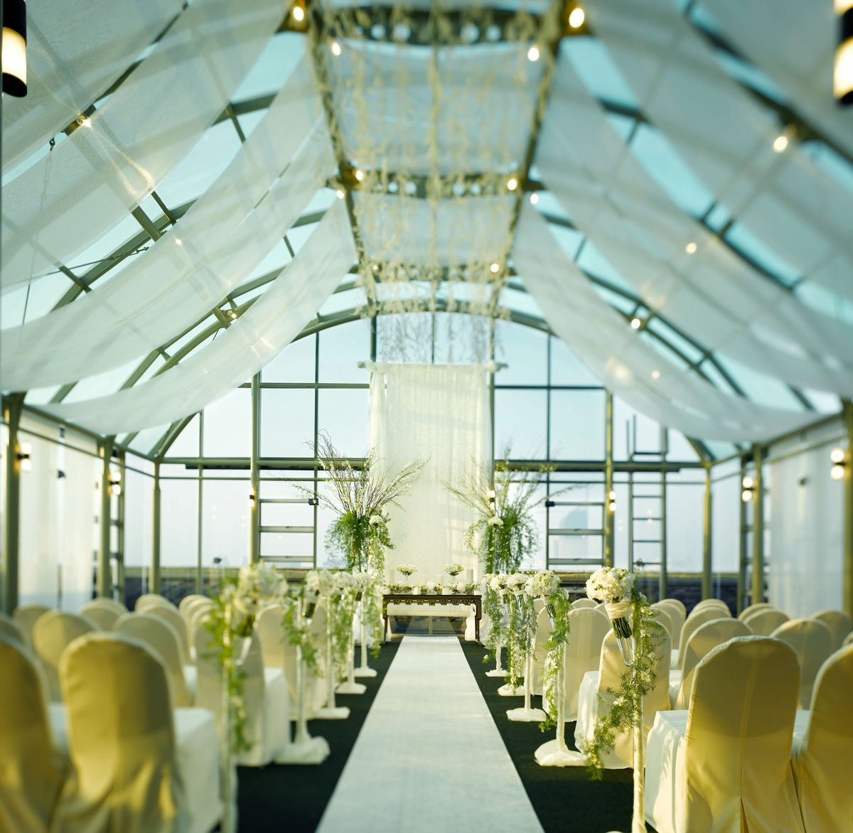 A Tasteful And Elegant Indoor Wedding Ceremony Held At