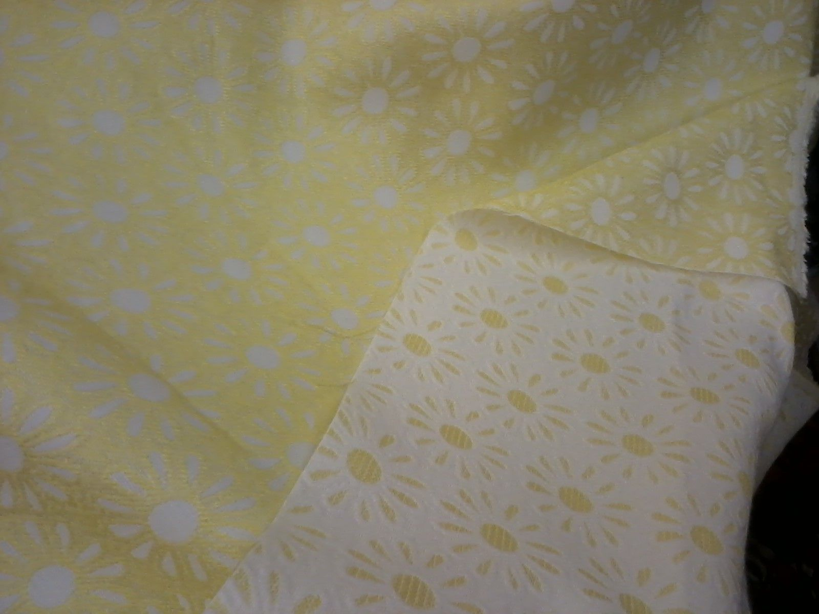 A great white and yellow heavy maybe for a jacket fabrics