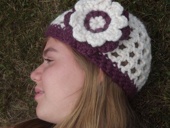 "Sale Ready to ship Hand Crocheted Womens Hat With by WillowPrairie, $25.00  This is my favorite hat in my collection the colors are an awesome combination. This hat will keep you warm on the cooler days of winter. It is a creamy white with a wide plum stripe around the bottom and a purple and white flower. The wool in this hat is not rough it is wool blend and is pretty soft.  Ready to ship.  Size: adult or teen (21"" with stretch) Color: White with Plum Fiber: Wool blend  Machine wash and…"