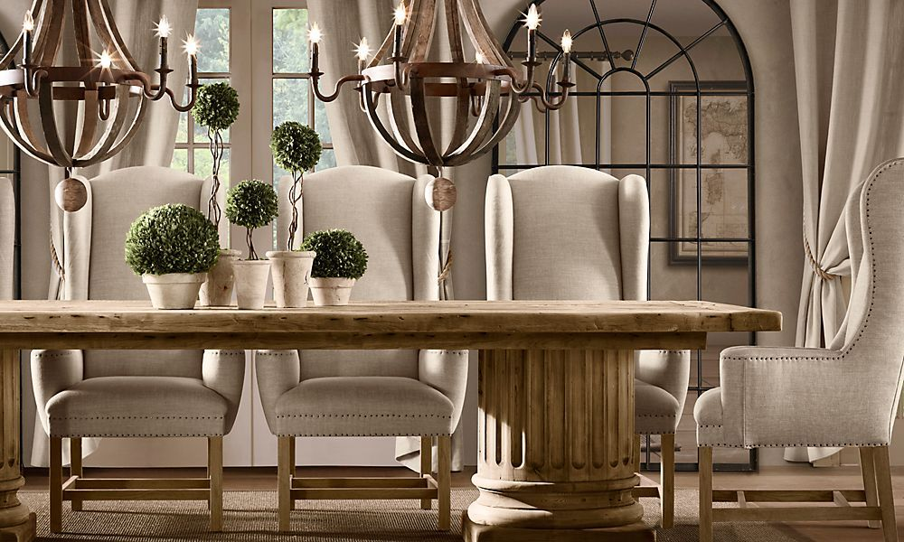 Dining Room With Double Chandelier Topiary Centerpiece Column Pedestal Table Wing Back Chairs Restoration Hardware