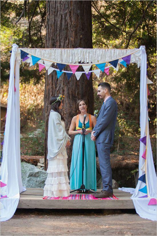 diy wedding arch and bunting #diy #weddingceremony #weddingchicks http://www.weddingchicks.com/2014/03/24/bohemian-diy-wedding/