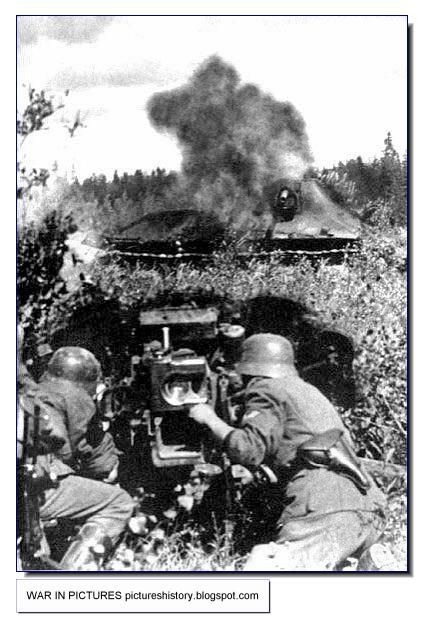 German 50 Mm Anti Tank Gun: A German 50 Mm Anti-tank Gun Hits A T-34 Tank