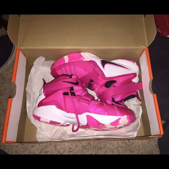 Pink Nike lebron soldier breast cancer edition Grade school lebron basketball shoe. Worn once. Size 5.5y. Equal to 7 in women's. Pink camo bottom. Breast cancer edition. Comes with box Nike Shoes Athletic Shoes