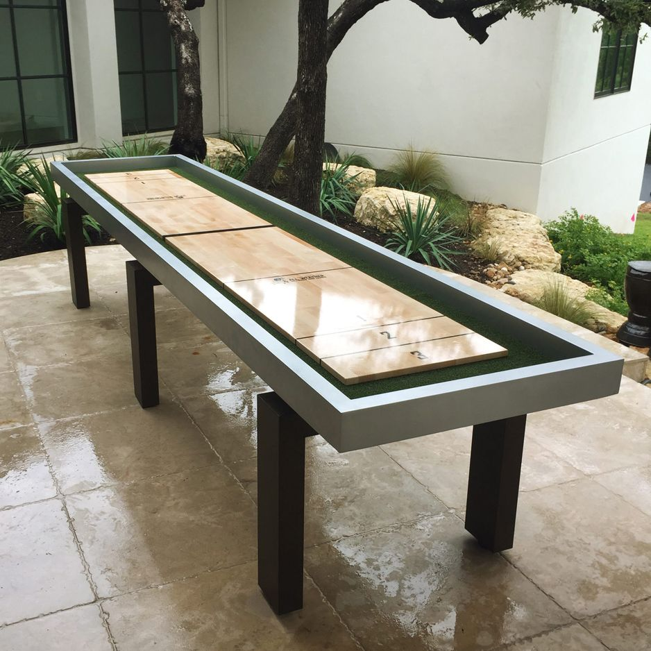 Play outdoors on this weatherproof shuffleboard. The rock