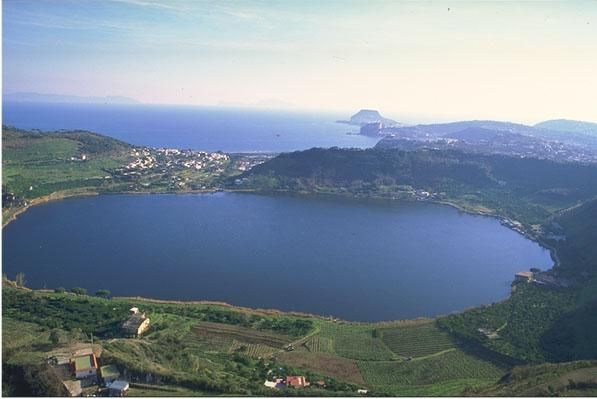 Lago d'Averno, a volcanic crater lake near Naplesand the volcanic field known as the Campi Flegrei and comprises part of the wider Campanian volcanic arc.