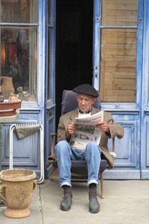 Reading a newspaper.