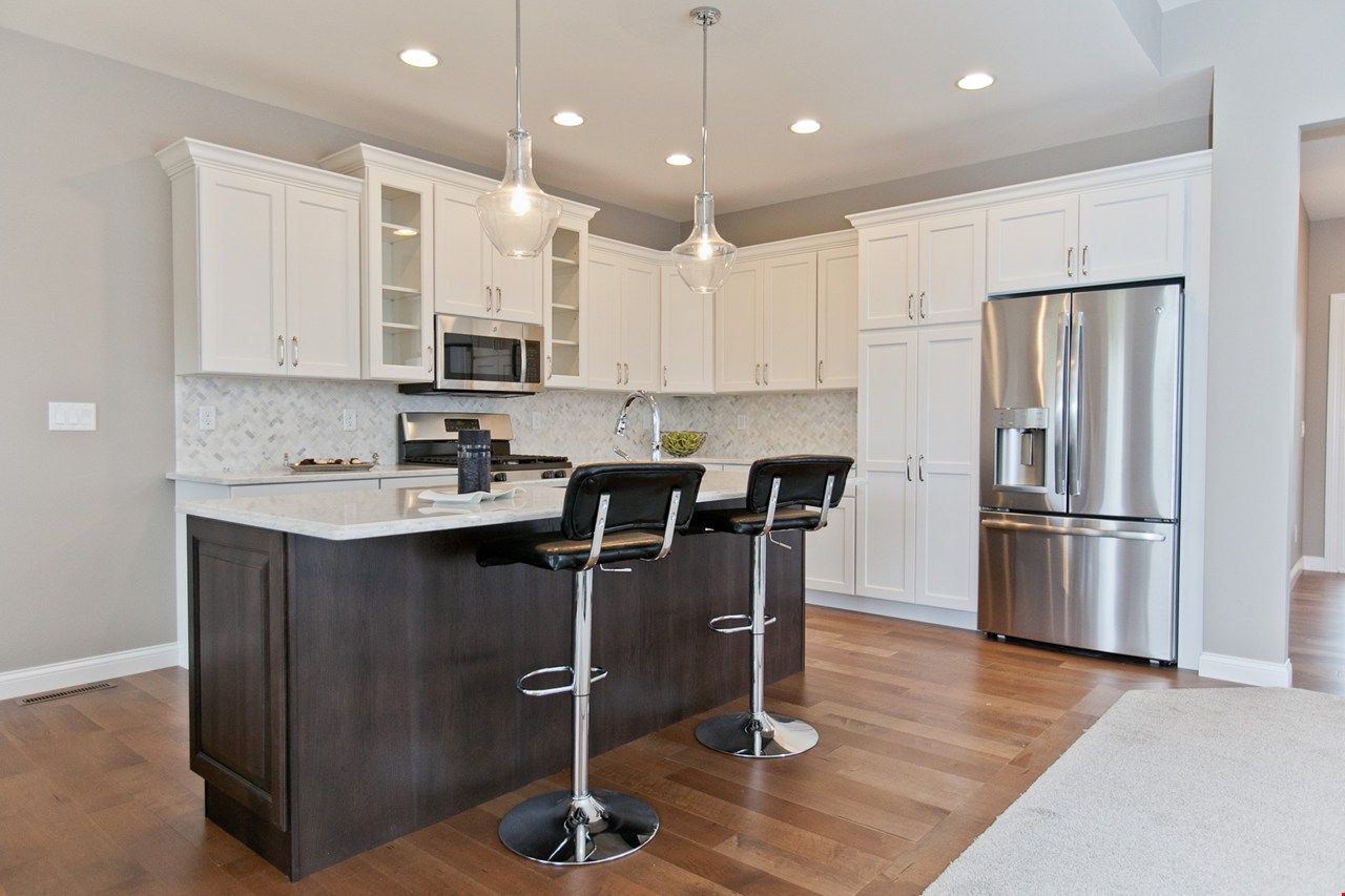 Two Tone Kitchen Cabinets Featuring White And Flagstone Cabinets In New Construction Home In Cedar Rapids New Home Communities Home Two Tone Kitchen Cabinets