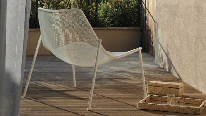 Back View Of White Emu Round Chair Outside On A Deck Active