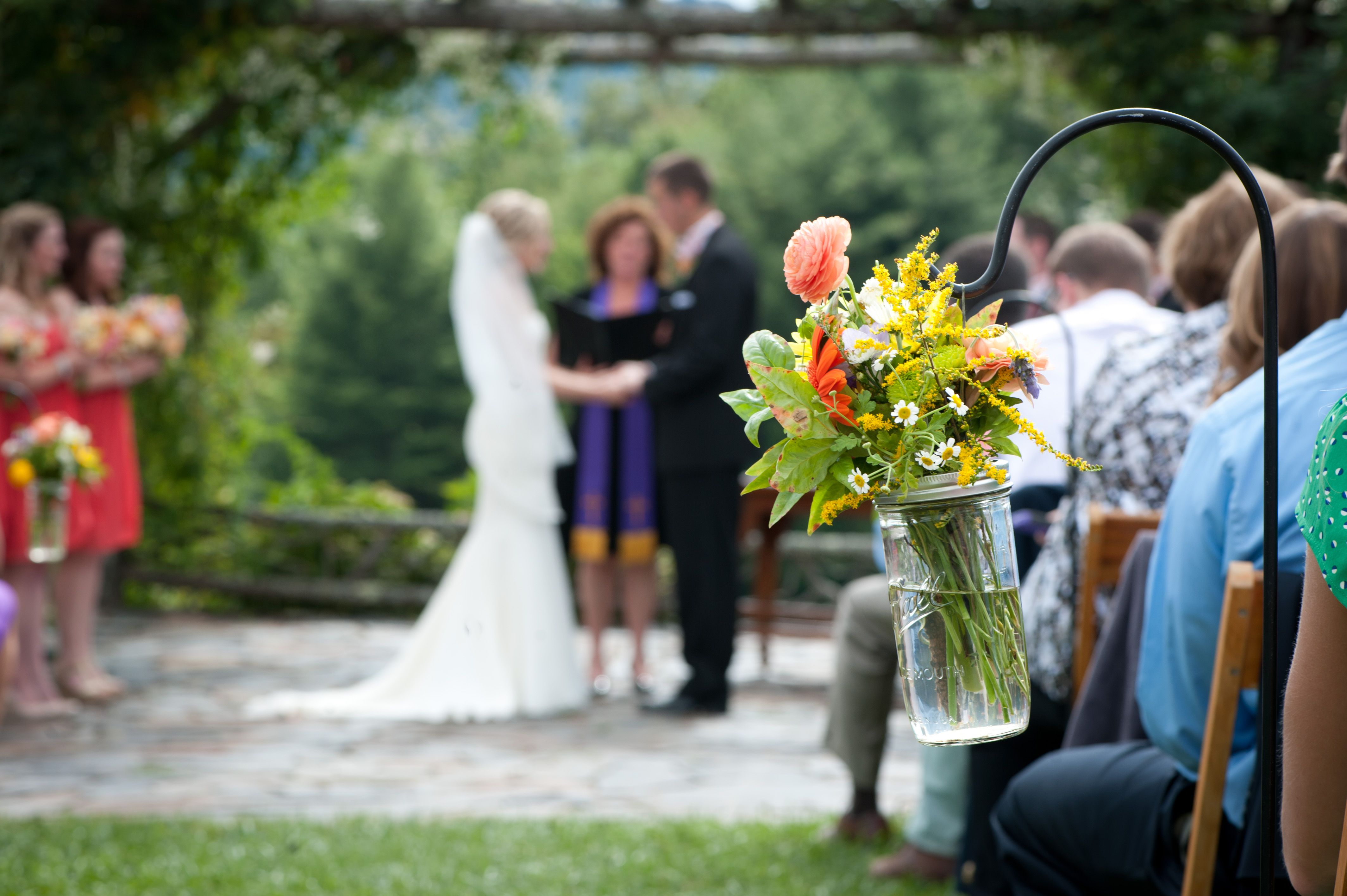 Our beautiful pergola does not require much for decorations, but I love the use of small bouquets down the aisle to add a little color!  #wedding #flowers #westernNC #weddingvenue #rustic www.sawyerfamilyfarmstead.com
