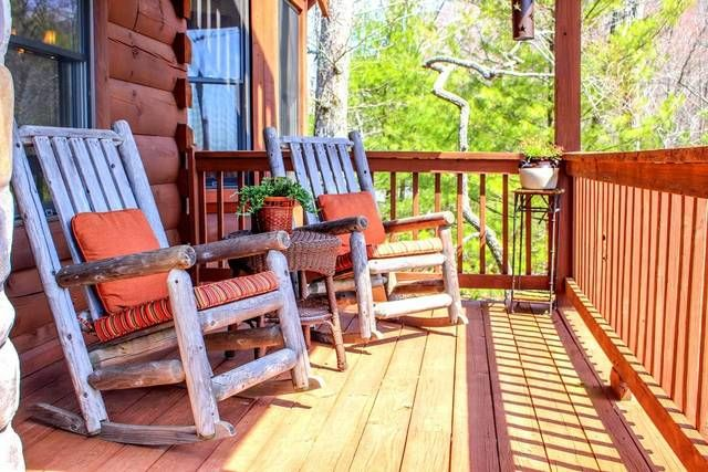 Two Chairs On The Porch Of One Of Our Cabins In Murphy, NC