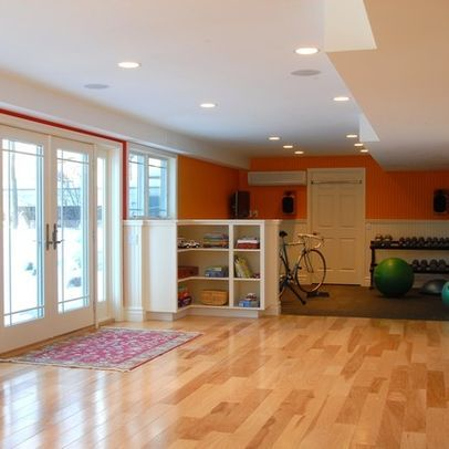 open play space and small workout area in basement with