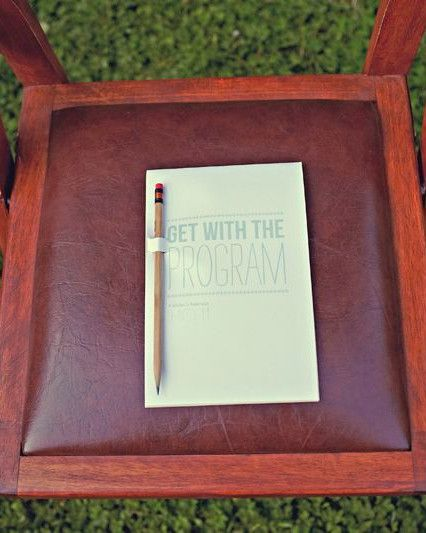 Vanessa and Calvin designed ceremony programs as booklets modeled after a kid's activity pad with built-in pencil holders to keep guests occupied before the ceremony got under way.