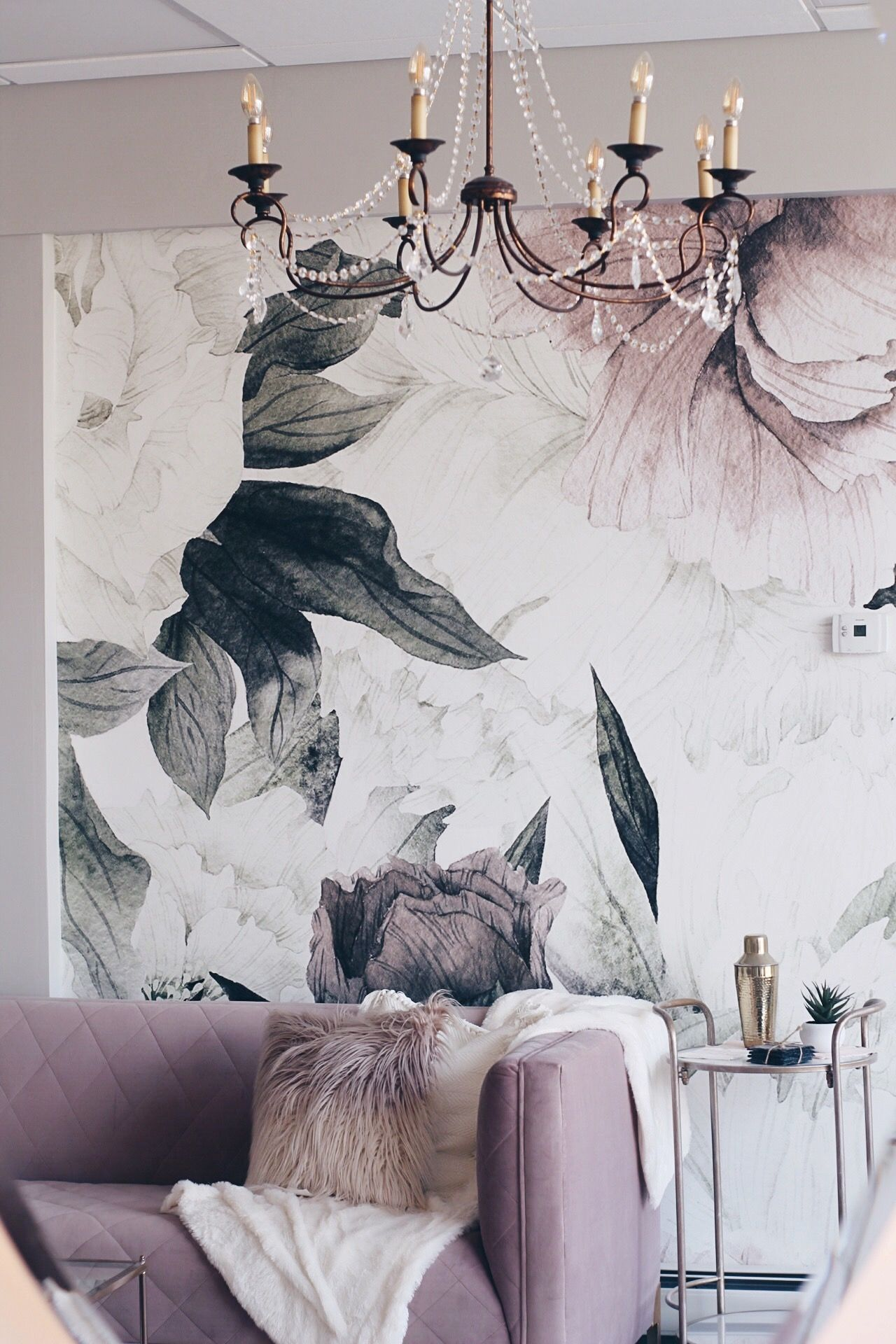 modern glam design with blush pink sofa and floral
