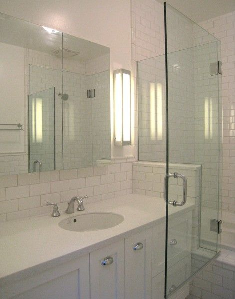Manhattan tnhse bathroom: tile to ceiling and all one color adds luxe without $$