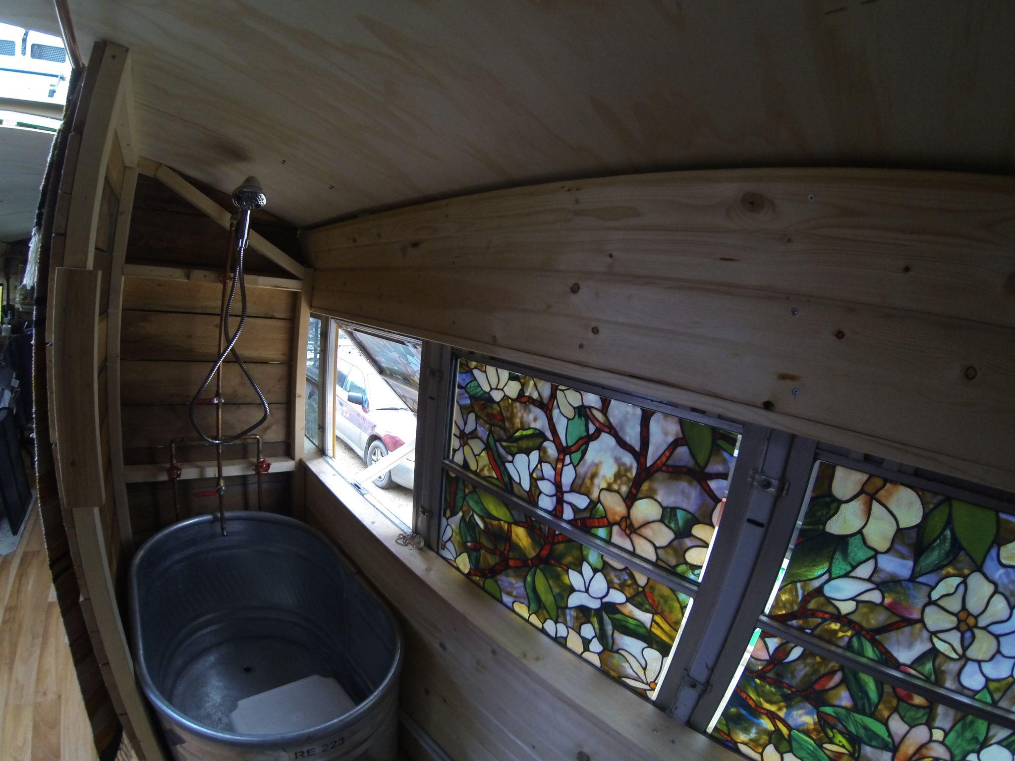 Bathroom Stock tank tub. Oxygenics shower head. Decals