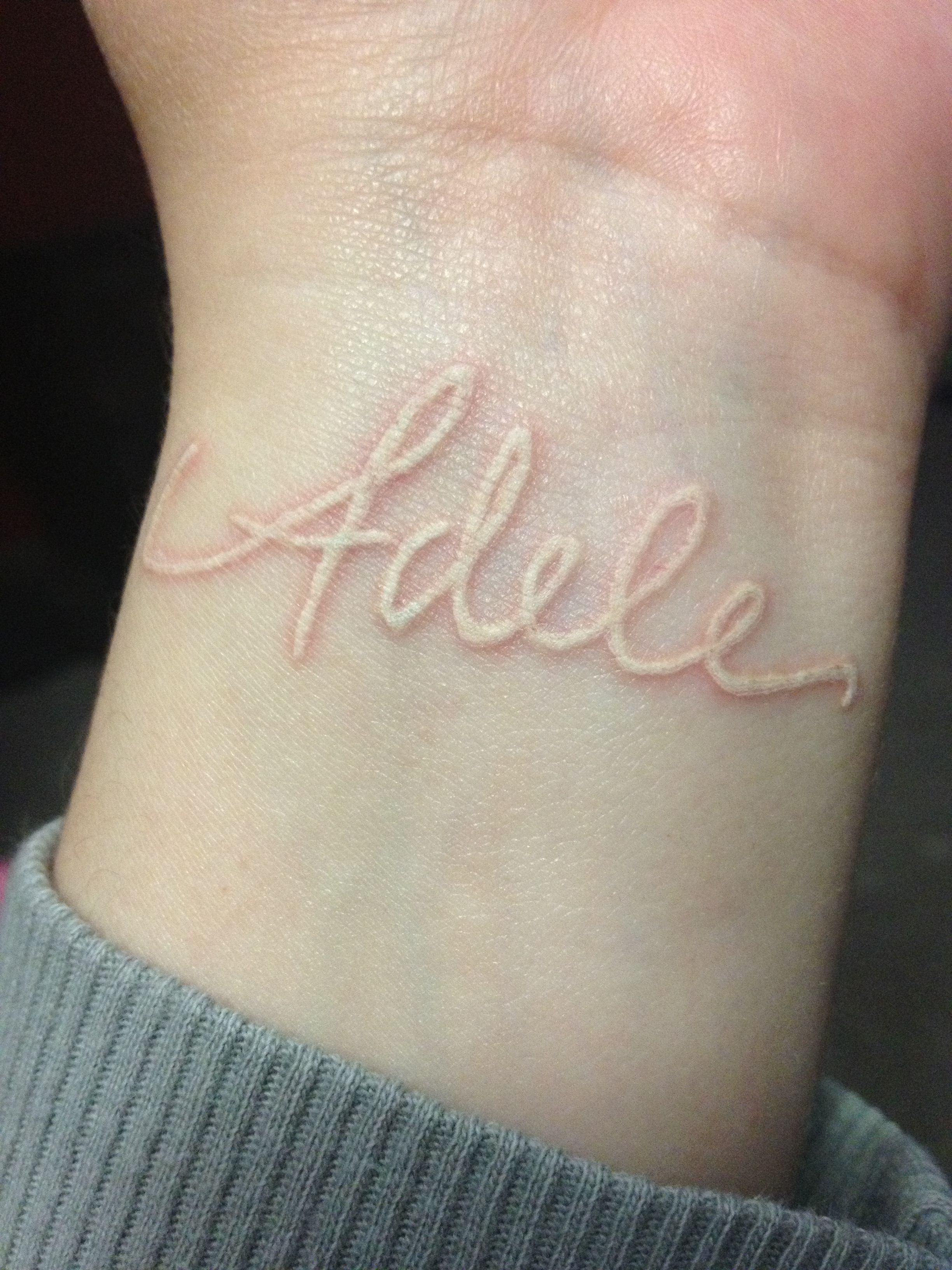 White ink wrist tattoo of my daughter\'s name. This is something I ...