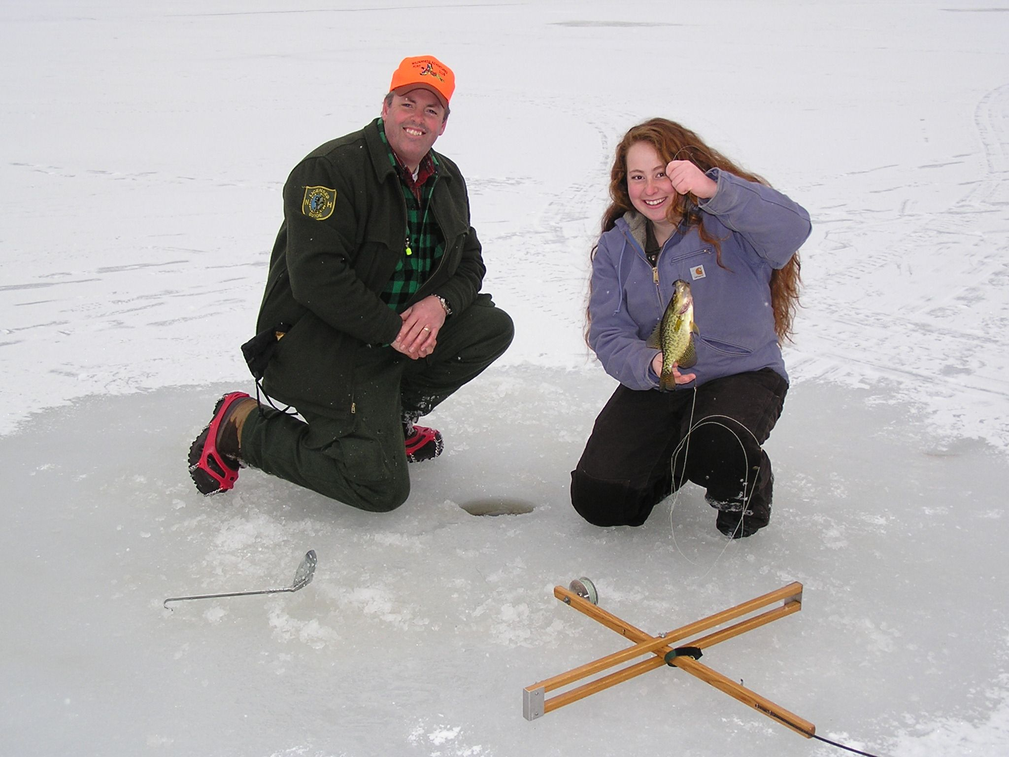 Success with a tip-up.  Great group of ladies taking an ice fishing class, Women's Outdoor Learning Center. Pickerel, Bass, Hornpout, Crappie, Bluegill.