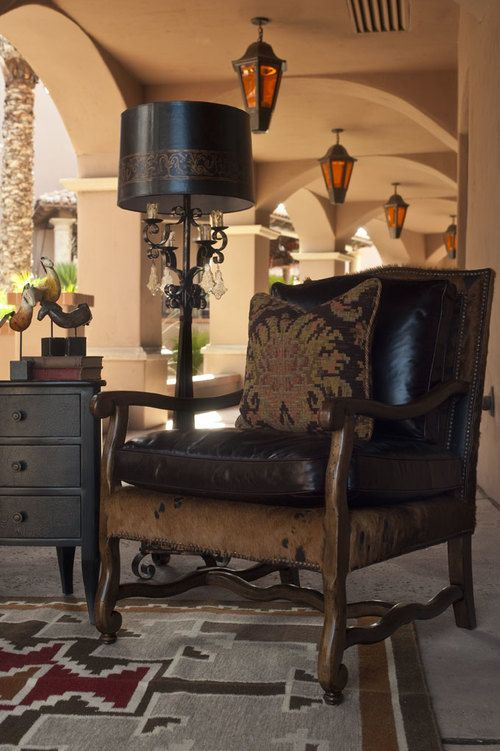 Hancock & Moore's Vestige Chair is one of our favorites! This beautiful chair is done in a smooth espresso-colored leather and a hair-on-hide base. #hancockandmoore #haironhide #southwest