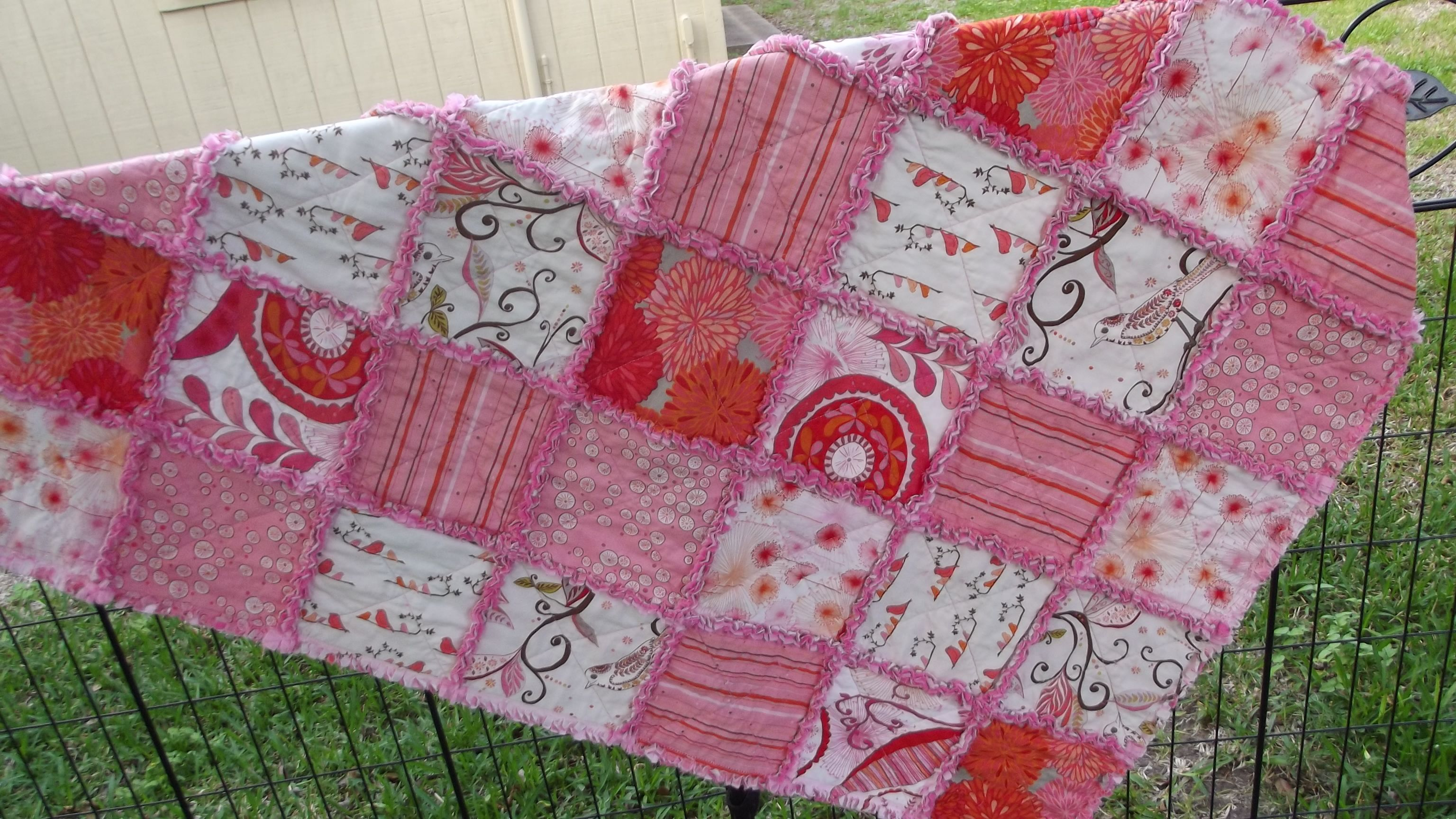 Wrenly in Pink lap rag quilt.  Rag quilts are great.  Come check out my shop today.   www.dawnsquiltedrags.etsy.com