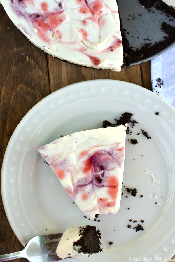 easy no-bake cheesecake with an Oreo crust and mixed berry swirls.