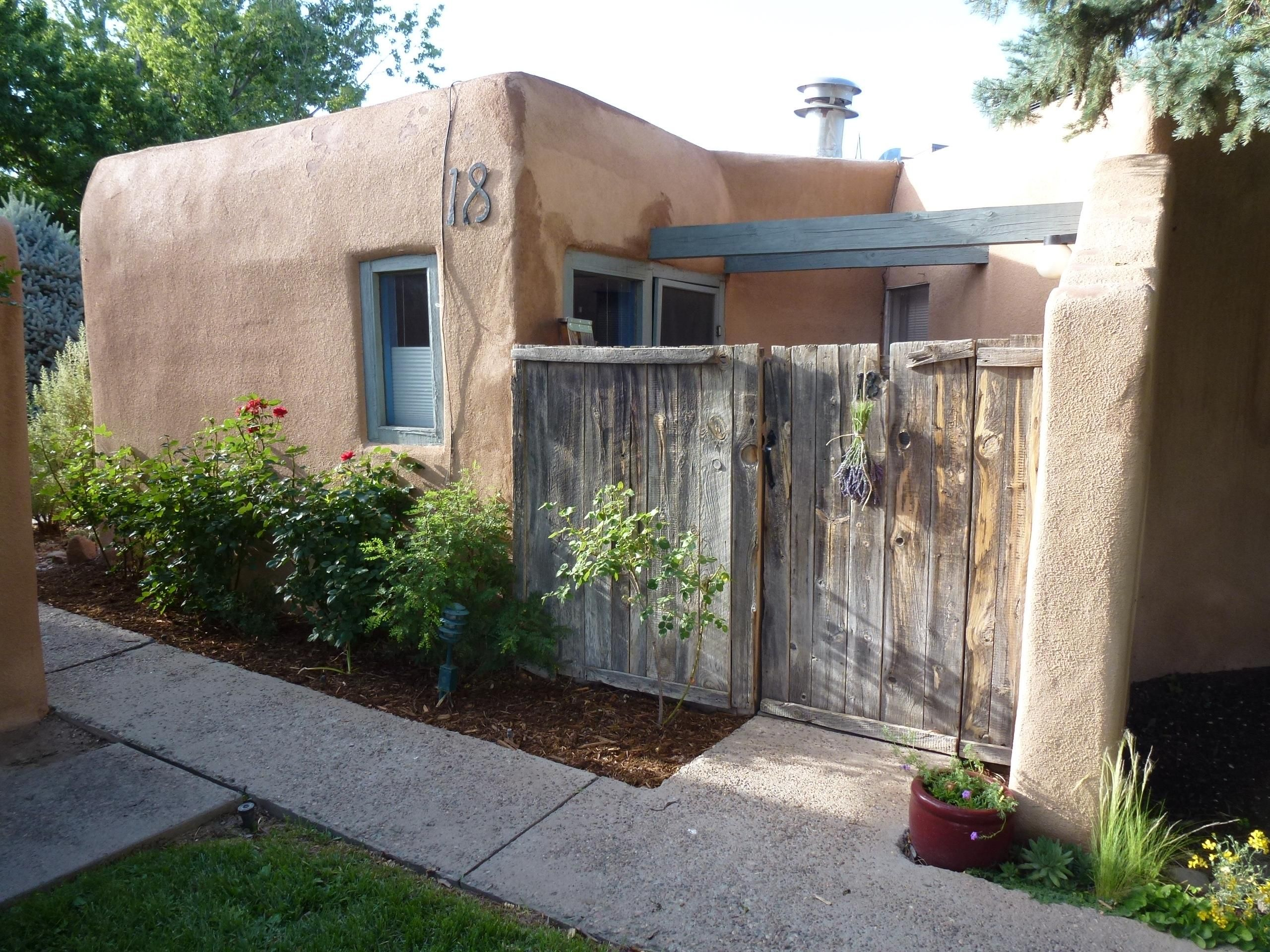 Traditional New Mexico Adobe Condo Albuquerque S North Valley Tiny House For Sale In Albuquerque New Mexico Tiny House Listings Adobe House Earth Homes Cabins And Cottages
