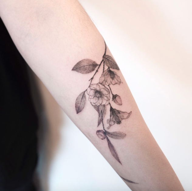 Camellia Flower Tattoo Inkstylemag Tattoos Cat Eye Tattoos Body Tattoos