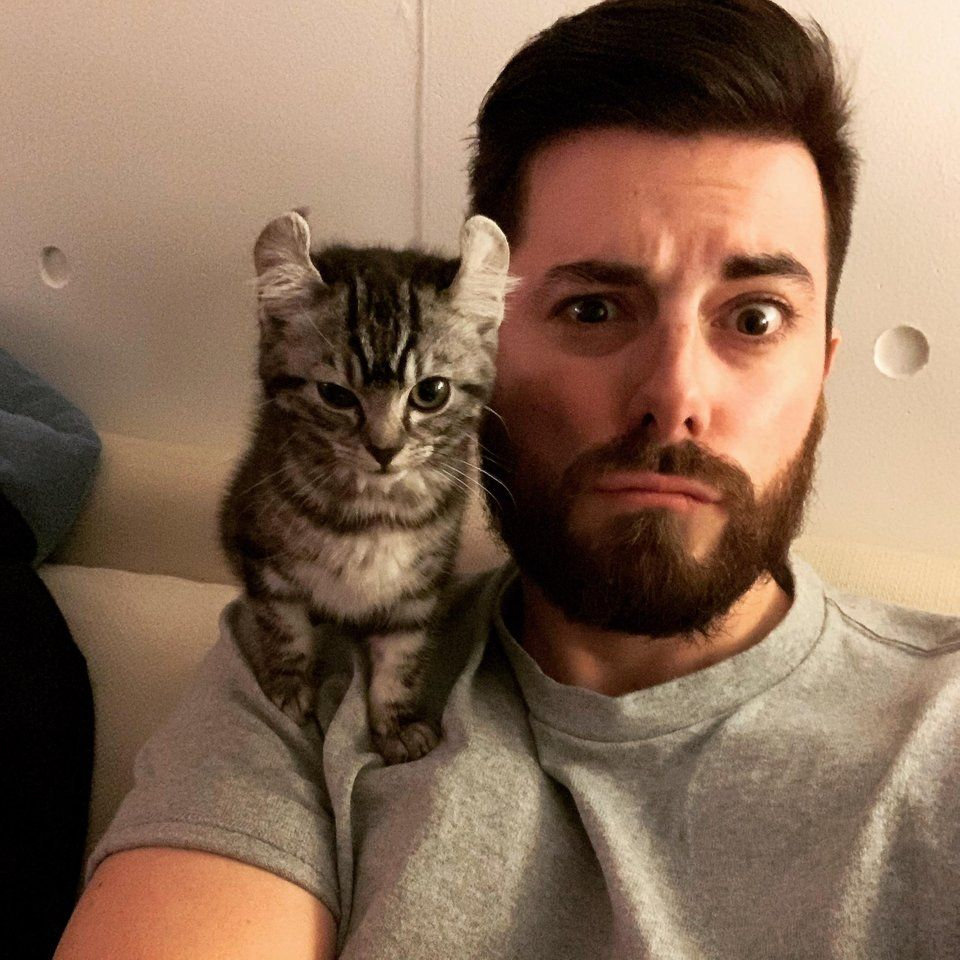 When your cat and you pose the same. This is my parrot