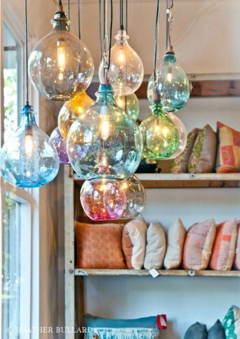 A Pendant Light With Colored Glass Balls Hanging From Different
