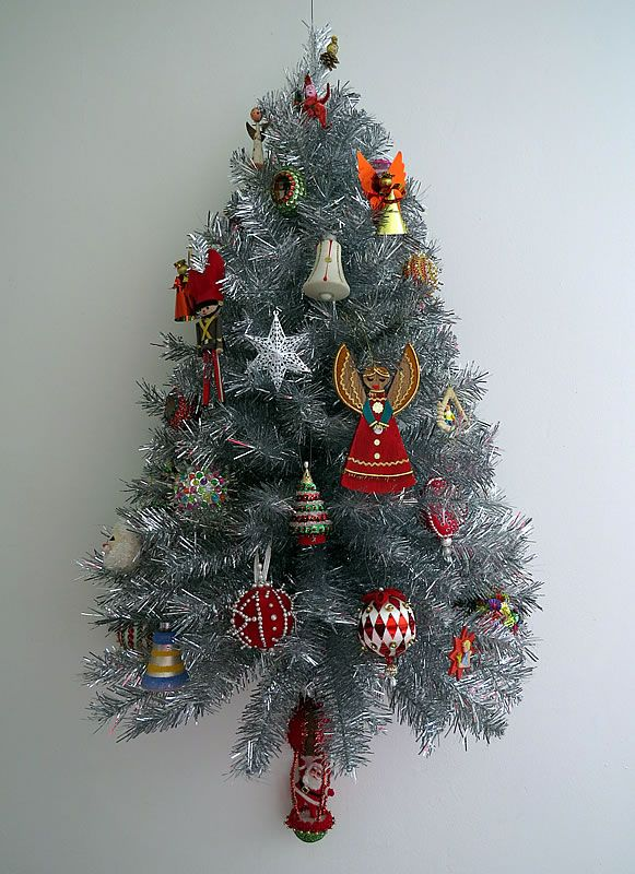"""Something modern: there are now hangable """"wall trees"""" (half trees) and """"corner trees"""" (quarter trees) available in various sizes online. Craft Daddy got a 3' silver wall tree to showcase his vintage ornaments (2014)."""