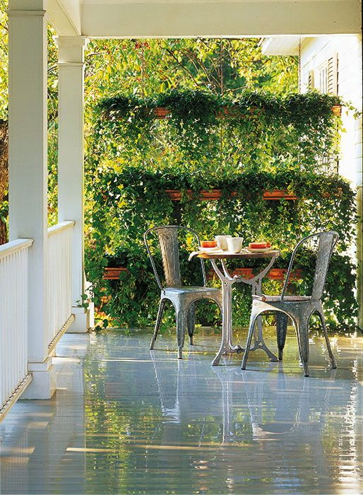 the use of copper gutters hung in tiers, with cascading vine ...