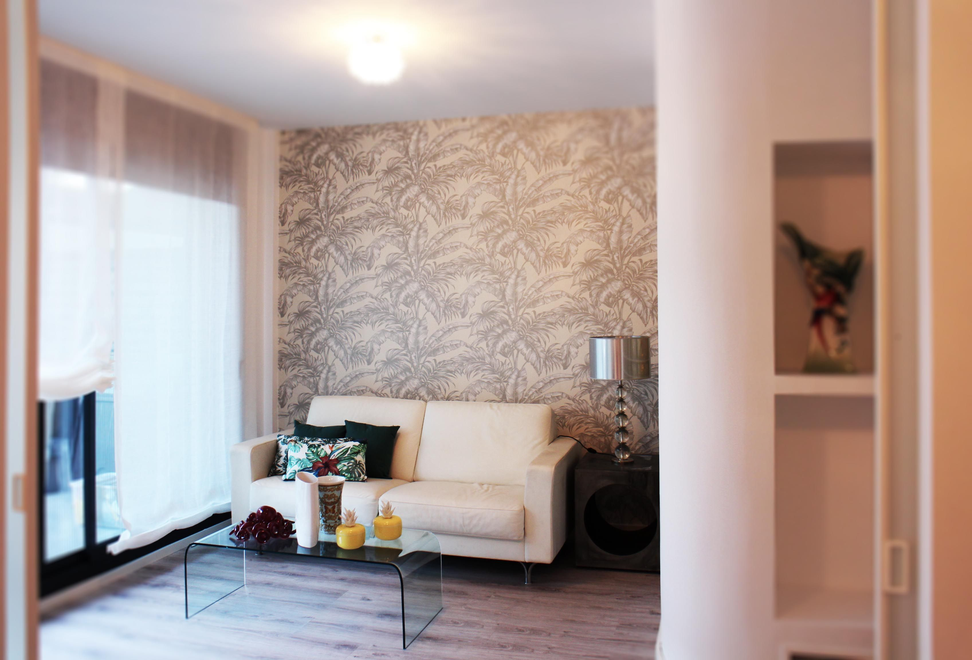 Lounge area Master bedroom. Silver palm leaves wallpaper