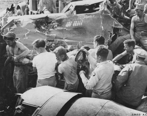Ground crew removing the injured and dead crew of a B24 Liberator.